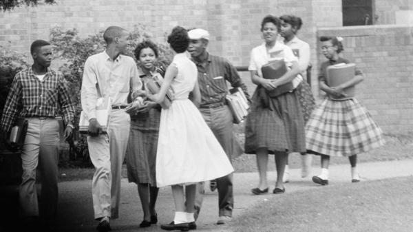 Eight of the nine black students who integrated Little Rock Central High School walk from school to their waiting Army station wagon on Oct. 2, 1957.