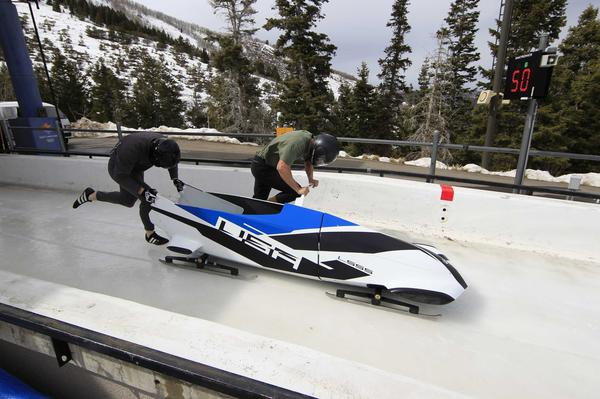 American bobsledders Justin Olsen and John Napier test BMW's two-man bobsled prototype in the Utah Olympic Park in 2012.