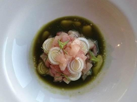 Hamachi with cattail, verbena, finger lime, white fir and sorrel broth at Girasol in Los Angeles.