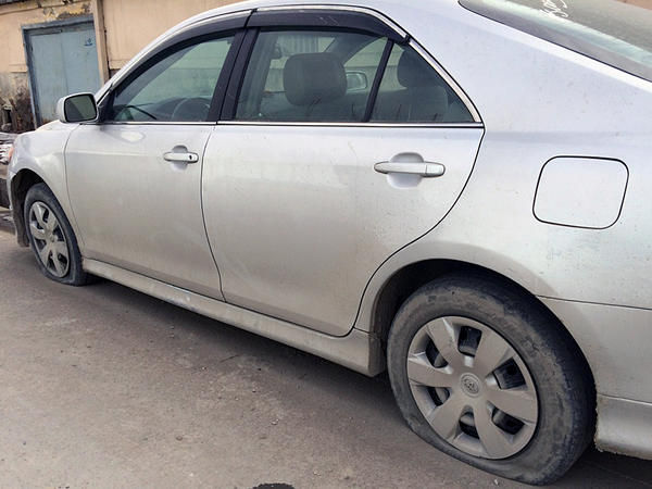NPR producer Sultan Faizy's car — parked right outside the NPR office in Kabul — was recently targeted by the police. Police say the policy is meant to prevent militants from stealing cars for use in bomb attacks.
