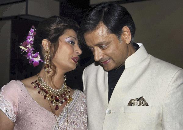 Shashi Tharoor listens to his wife Sunanda Pushkar at their wedding reception in New Delhi, India in 2010.