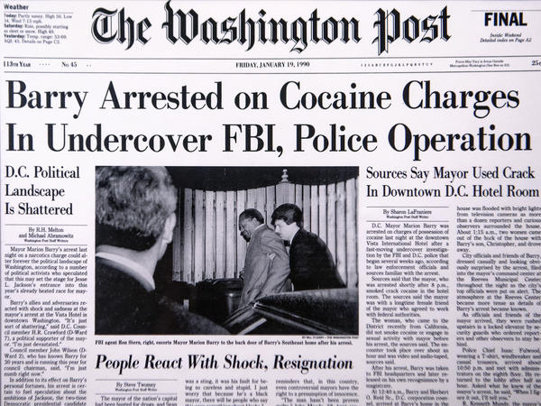 Bill O'Leary's photo of Marion Barry getting escorted by an FBI agent made the front page of the Jan. 19, 1990, issue of <em>The Washington Post</em>.