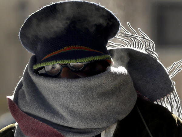 """Here we go again. Earlier this month in St. Louis, Jerome Harris bundled up against frigid temperatures. Now, cold air is again rushing south from the Arctic and a """"bomb"""" of a storm is brewing across much of the Eastern half of the nation."""