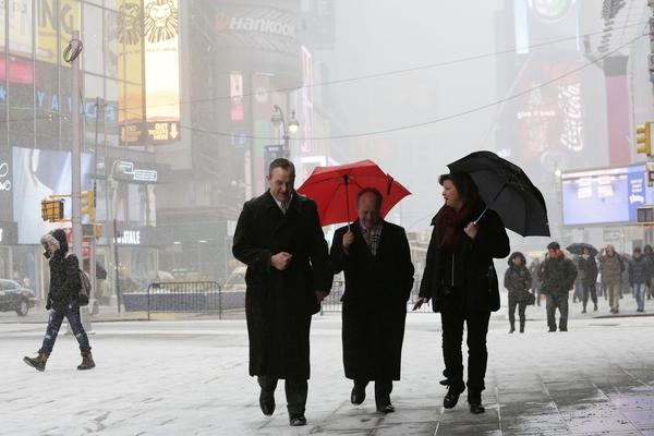 Pedestrians make their way through the snow in New York's Times Square.
