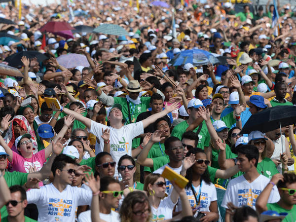 Catholics attending World Youth Day await the arrival of Pope Francis for the final Mass of his visit to Brazil, at Copacabana beach in Rio de Janeiro on July 28.