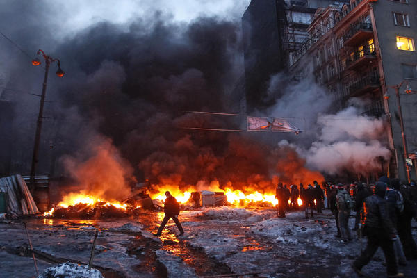 Protesters kept fires burning throughout the night Wednesday. On Jan. 16, Ukraine's parliament issued tougher security laws, which prompted tens of thousands of protesters to take to the streets.