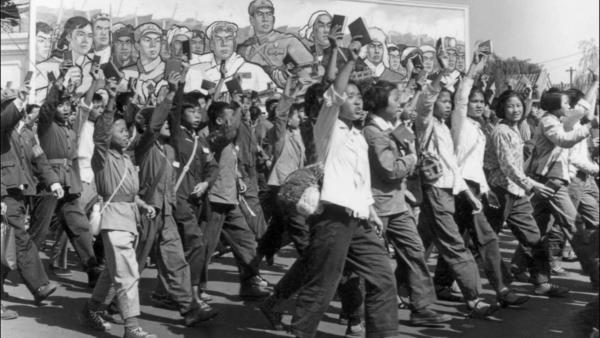 Red Guards — high school and university students — wave copies of Chairman Mao Zedong's <em>Little Red Book</em> during a parade in June 1966 in Beijing's streets at the beginning of China's Cultural Revolution. More than 1 million people are believed to have died during the decade-long upheaval.