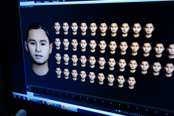 In their effort to make their animations seem more realistic, the Next Media team models various facial expressions it will use in a piece. These are models of singer Leslie Cheung.