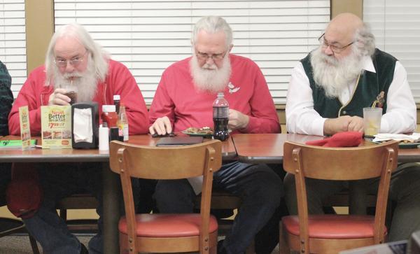 Santas eat before meeting begins. (Eric Mennel/WUNC)