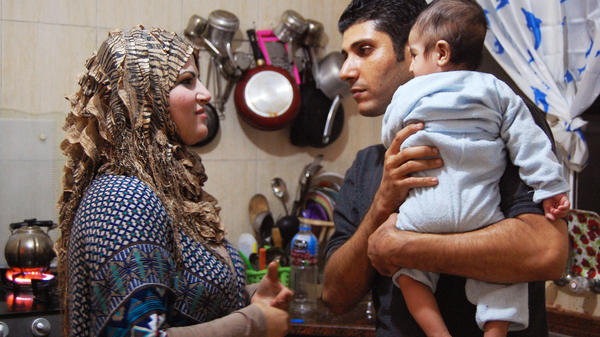 "Ala'a Miqbel (shown here with his wife and their youngest son in their Gaza City apartment) was held for nearly four weeks in an Israeli prison, then released without charges. There, he met the ""sparrows"" — Palestinians who appear to be fellow prisoners but are actually gathering information for the Israelis."