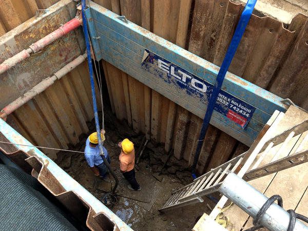 The Sant'Omobono excavation team dug a 15-foot reinforced hole below the water line.