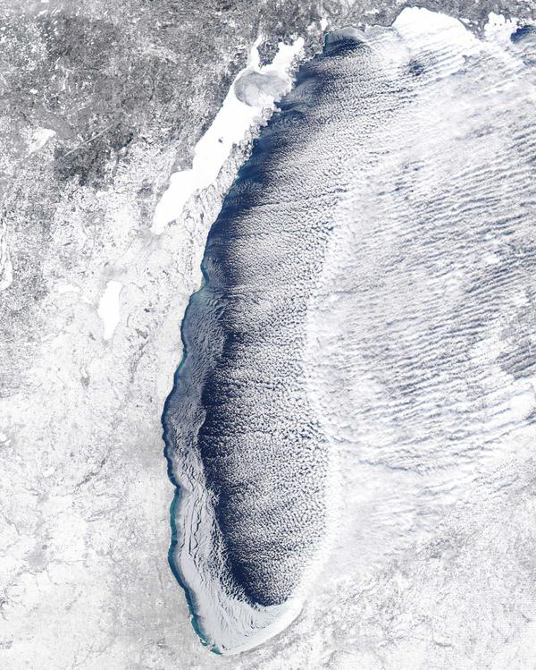 Lake Michigan, now partially frozen, as snow and clouds blow over.
