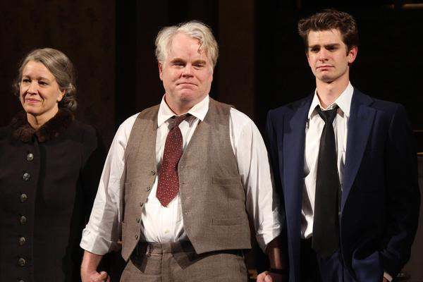 Linda Emond, Hoffman and Andrew Garfield take their opening night curtain call in Arthur Miller's <em>Death of a Salesman</em> at The Barrymore Theatre in New York City in 2012.