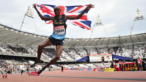 Britain's Mo Farah jumps in the air after winning in the men's 3000 meters at International Association of Athletics Federations championships at the Olympic Stadium in London on July 27, 2013. Major Olympic venues continue to be used in London.