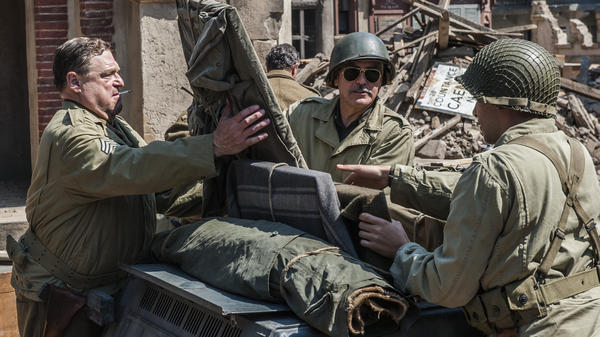 Frank Stokes (George Clooney), Walter Garfield (John Goodman) and Sam Epstein (Dimitri Leonidas) are part of a World War II platoon ordered to rescue stolen art from the Nazis in <em>The Monuments Men</em>, directed by George Clooney.