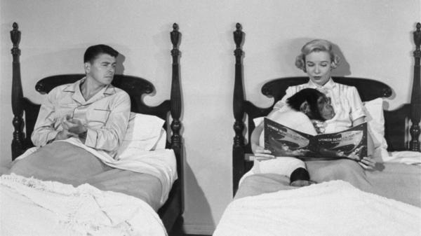 Ronald Reagan, portraying a chimpanzee-raising professor, is shown with Diana Lynn in a scene from the 1951 film <em>Bedtime for Bonzo</em>.