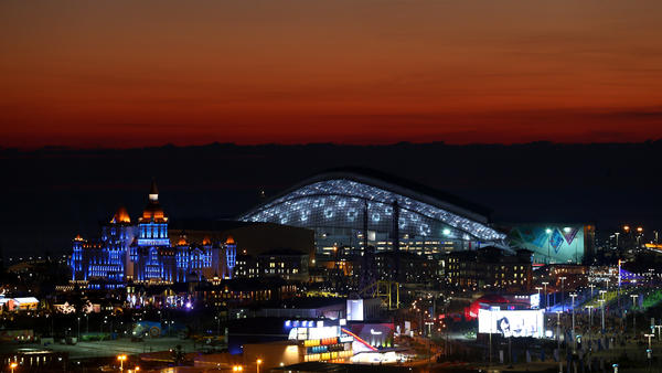 The sun sets at the Olympic Park just ahead of the Opening Ceremony of the Sochi 2014 Winter Olympics at Fisht Olympic Stadium in Russia.