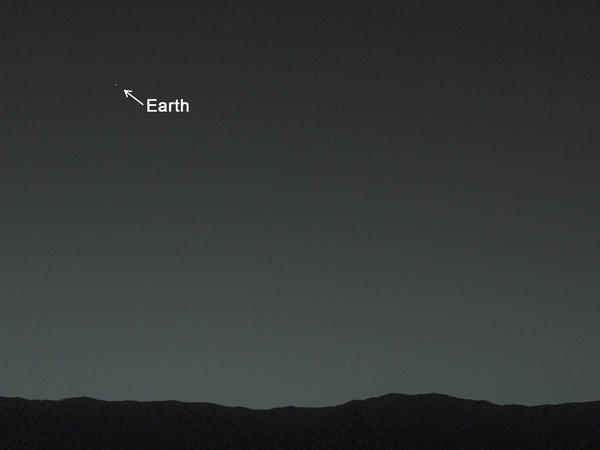 From 99 million miles away on Mars, Earth is just a tiny dot in the evening sky.