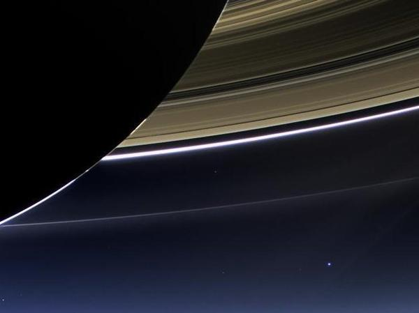 In July 2013, NASA's Cassini spacecraft was about 1 billion miles from Earth — which is the bright spot toward the bottom right of the photo, below Saturn's rings — when it took this image.