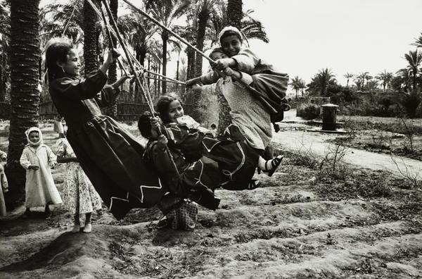 Schoolchildren on a homemade swing at Rosetta, Egypt, in 1947.