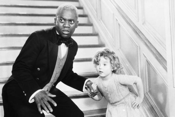Bill Robinson, as the butler, teaches Shirley Temple his world-famous stair dance in a scene from<em> The Little Colonel</em> in 1935.
