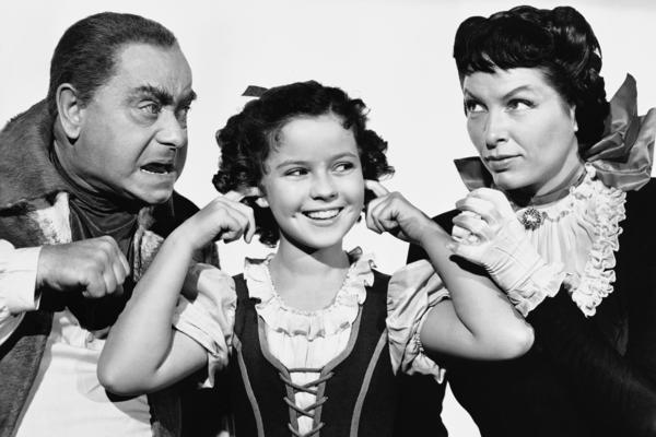 Temple with Eddie Collins and Gale Sondergaard from a scene of the 1940 movie <em>The Blue Bird</em>.
