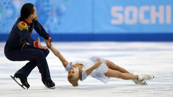 Russia's Maxim Trankov and Tatiana Volosozhar helped Russia take gold during the team figure skating competition in Sochi.