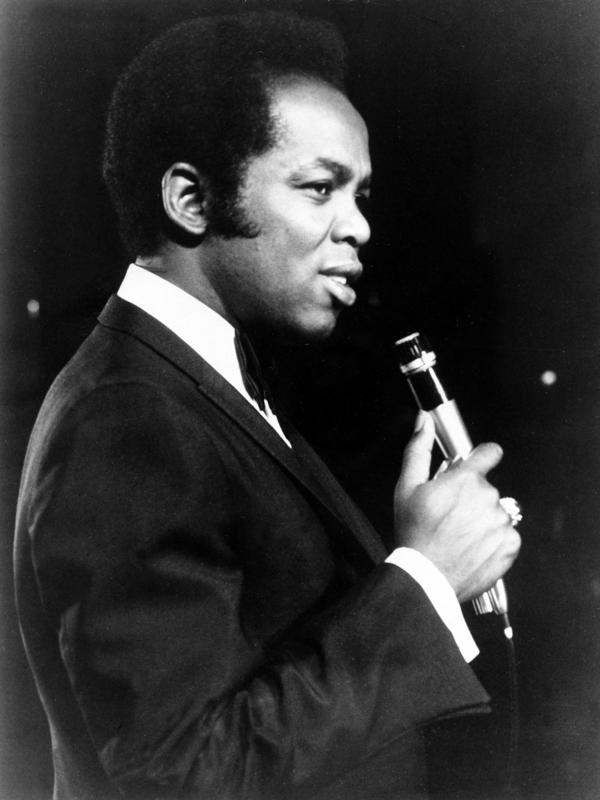 Lou Rawls performs in January 1971. The singer was one of a few black performers who got their start working the Chitlin' Circuit.