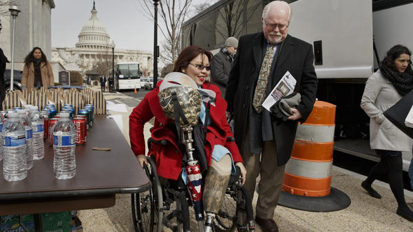 Rep. Tammy Duckworth, D-Ill., and Rep. Ron Barber, D-Ariz., right, pick up box lunches on Feb. 12 before boarding a bus for a trip to a retreat in Cambridge, Md., where House Democrats will hold strategy meetings for two and a half days.