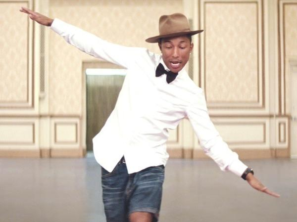 "Pharrell in the music video ""Happy."""
