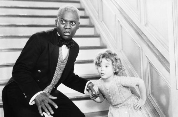 """Bill """"Bojangles"""" Robinson and Shirley Temple perform their famous stair dance in the 1935 film <em>The Little Colonel.</em>"""