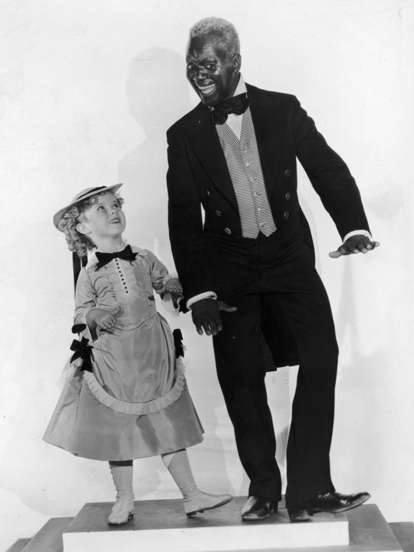Temple and Robinson, shown here in promotional pictures for <em>The Little Colonel,</em> shared an offscreen friendship. Shirley Temple Black says that as a child, she didn't realize how much racism Robinson faced.