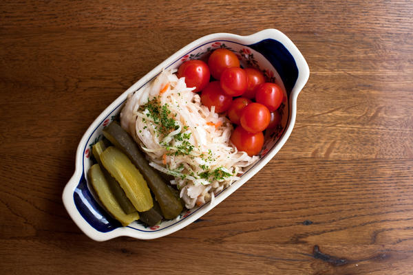Traditional pickled vegetables include tomatoes and cabbage.