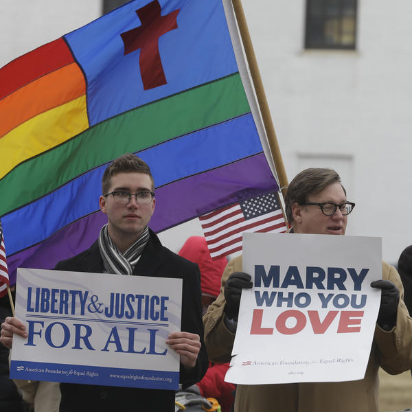 Virginians demonstrate outside Federal Court in Norfolk, Va., on Feb. 4. The judge ruled this week that Virginia's ban on gay marriage is unconstitutional.