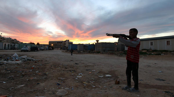 A child from the town of Tawargha holds a toy gun at a refugee camp in Benghazi on Jan. 12. His town was cleared by militiamen who accused residents of allying with Moammar Gadhafi.