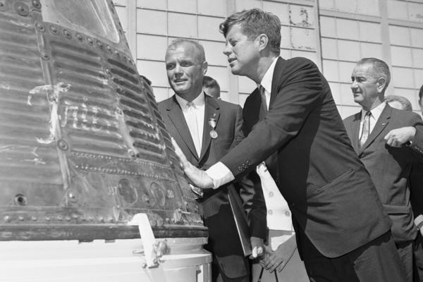 Glenn and President John F. Kennedy inspect the Friendship 7 capsule that Glenn rode into space. Kennedy presented the Distinguished Service medal to Glenn at Cape Canaveral, Fla., on Feb. 23, 1962. Vice President Lyndon Johnson is in the background.