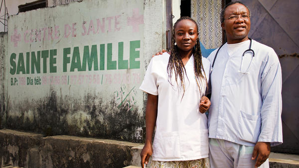 Sylvestre Mebam (right) runs an unauthorized health clinic in Cameroon's largest city of Douala. He and his assistant treat about 10 to 15 people each day.