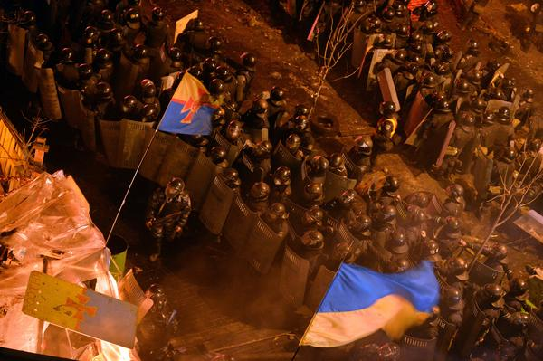 Riot police move into the protesters' main camp on Independence Square. Late last year, President Viktor Yanukovych rejected a trade deal with the European Union in favor of closer ties with Moscow, leading to protests against his government.