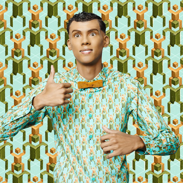 "Belgian music sensation Stromae acts as a mannequin in the music video for ""Papaoutai."""