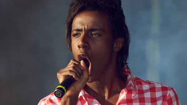 Mo performs in 2011, the year he rose to prominence on Norway's version of <em>The X Factor</em>.