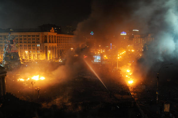Fires burn in Independence Square on Wednesday. Bloodshed in the country has claimed more than two dozen lives since Tuesday.