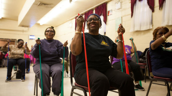 Linda Beckford (right) exercises as part of a walking group that tries to make their neighborhood a better place to live. If nothing else, the seniors feel more confident about going outside.