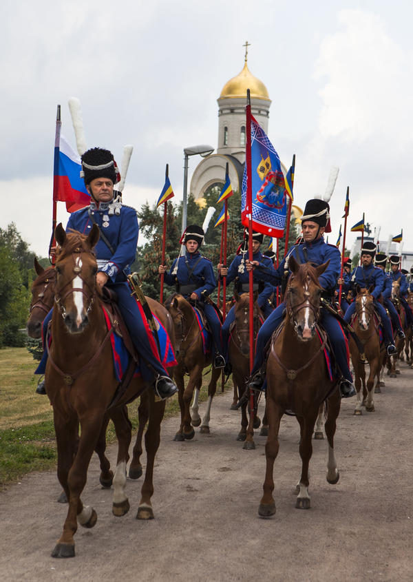 Cossacks, who formed a feared military force in czarist times, start their 2012 ceremonial march from Moscow to Paris in memory of soldiers killed during the war against Napoleon in 1812.