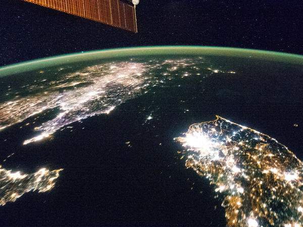 This image was taken on Jan. 30 by astronauts aboard the International Space Station. North Korea is the large dark patch in the middle. The only significant light is from its capital, Pyongyang. The next photo adds reference points.