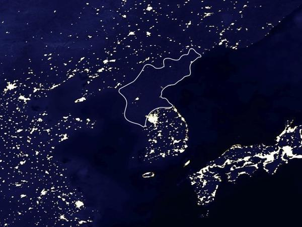 A 2002 satellite image of the Korean peninsula and neighboring lands and seas. North Korea's borders are outlined in white.