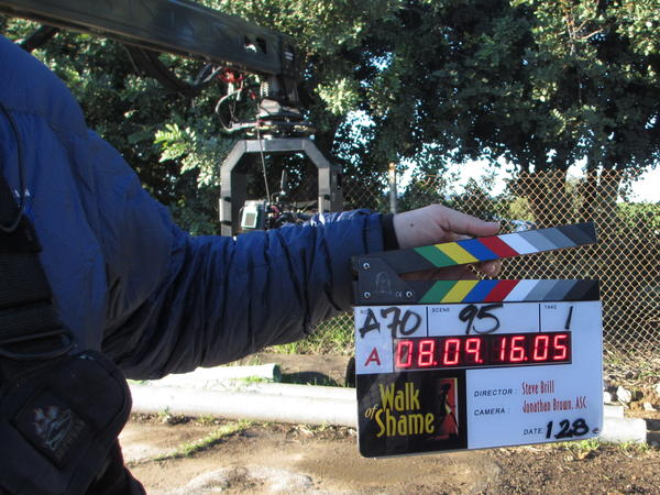 """Janicin shows off a """"smart slate"""" on the set of <em>Walk of Shame. </em>The digital timer and embedded chip allow for easy syncing of video and audio in post-production."""