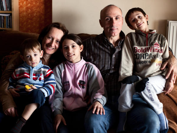 Alexandra Tsitoura and Nikos Aivatzidis with their three children, Marios, 2, (left), Fani, 9, and Dimitris, 6, in their home in Athens.