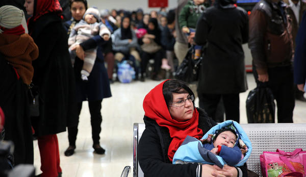 An Iranian woman holds her child at the Mofid Children's Hospital in Tehran, Iran. Having curbed birth rates for two decades, Iran is once again promoting a baby boom to help make up for its graying population.