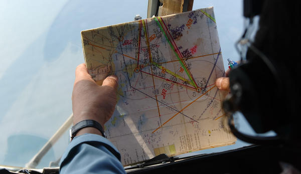As the search for Malaysia Airlines Flight 370 has expanded, teams from many countries have been involved. This navigator was aboard a Vietnamese helicopter searching the waters off that nation's coast.