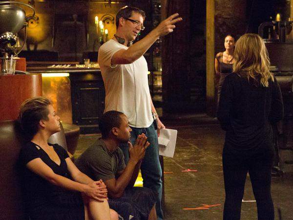 Rob Thomas directs Kristen Bell (right), Percy Daggs (center) and Tina Majorino on the set of the <em>Veronica Mars</em> movie.